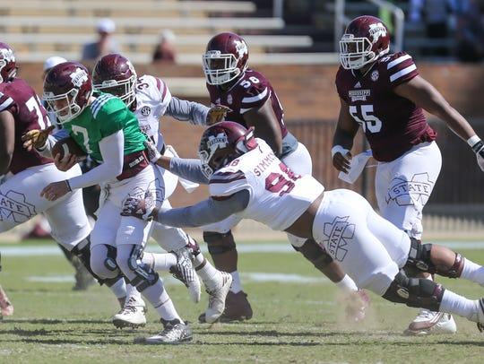 Maroon team member's Nick Fitzgerald  (7) escapes the