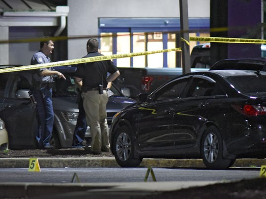 Police investigate a shooting early Sunday morning, July 9, at the Denny's east of Salisbury.