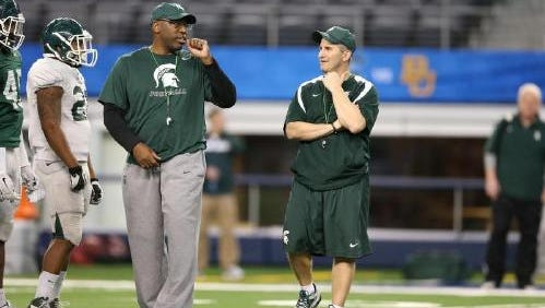Harlon Barnett (right) and Mike Tressel (left) are set to take over as MSU's co-defensive coordinators.