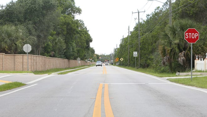 Looking west along Shangri-La Road. The road, about 1.25 miles long, has three stop signs Bonita Springs High School buses would need to pass when driving to Old 41 Road. Two are only about 750 feet apart — two and a half football fields long.