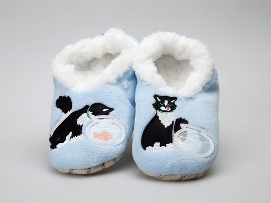 Snoozies slippers, $14.99, at the Glue Factory.