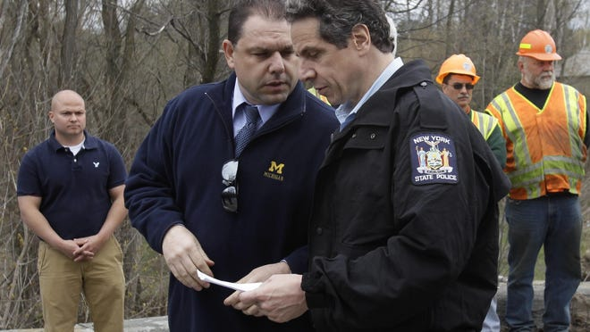 Joe Percoco, left, is seen with Gov. Andrew Cuomo in this file photo. Percoco, one of the governor's closest aides for decades, is facing corruption-related charges in the latest scandal to rock Albany.