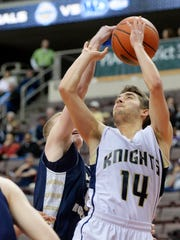 Bishop McDevitt's Chris Briner blocks a shot by Eastern York's Ryan Kalke in the second half of the District 3 Class AAA boys' basketball title game Thursday, Feb. 25, 2016, at the Giant Center in Hershey. Eastern York, making its first appearance in the title game since 2011, lost 71-47 to Bishop McDevitt.