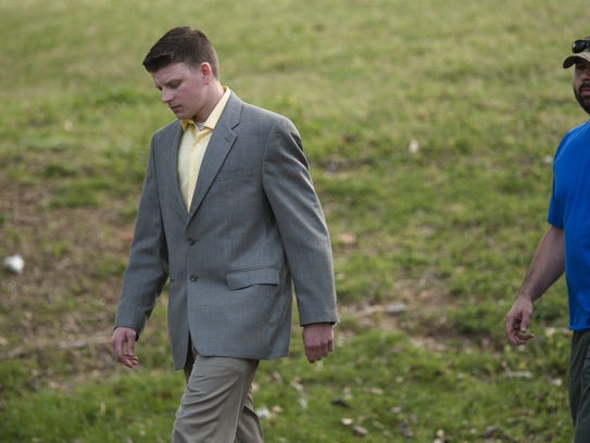 """Aaron """"A.C."""" Smith, left, walks away from the Montgomery"""
