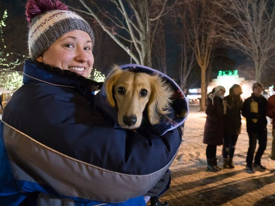 Tiffany Zabinski and Luna brave the cold to see the ice carvings at night. Tiffany and Luna are from Canton.