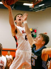 Blackman's Nathan Nelson (4) goes up for a rebound as Cumberland County's Braden Qualls (3) defends him on Friday, Dec. 1, 2017, at Blackman.