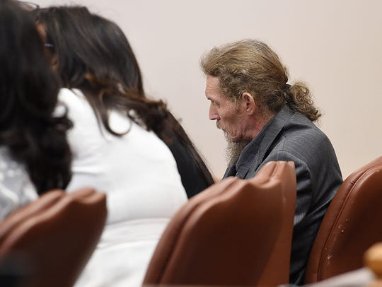 Doug Dyer sits in court during a trial at the Larimer