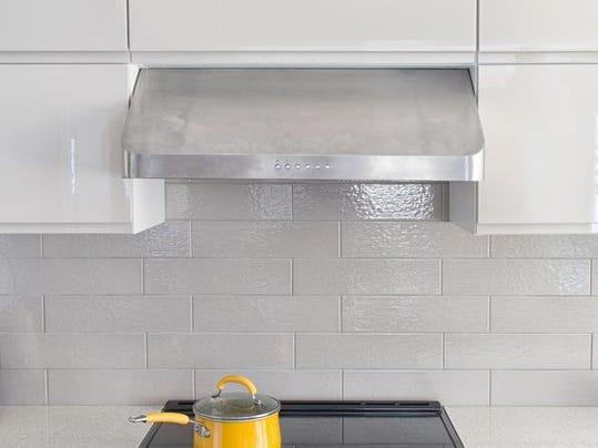 Modern kitchen range with yellow cooking pot