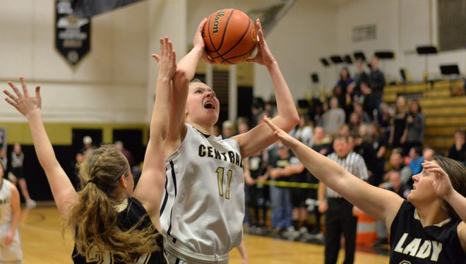 Central Magnet's Kylea Carver (11) scored 12 points in a loss to Macon County on Tuesday to end Central Magnet's season.