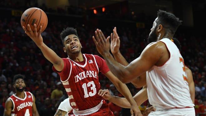 Indiana Hoosiers forward Juwan Morgan (13) shoots as Maryland Terrapins forward Joshua Tomaic (33) defends during the first half at Xfinity Center.