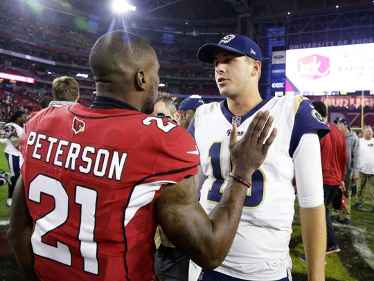 Cornerback Patrick Peterson congratulates Rams quarterback Jared Goff after the Cardinals' 32-16 loss to L.A. on Dec. 3.