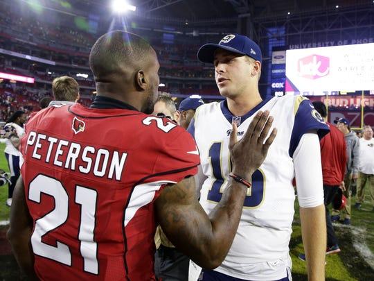 Cornerback Patrick Peterson congratulates Rams quarterback Jared Goff after the Cardinals' 32-16 loss to L.A. on Dec. 3.