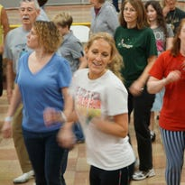 Jilly Ann Sweitzer, 8 years old of Bucyrus, shows off her clogging skills during a break Saturday at the 1st annual Cabin Fever Clogging Workshop.