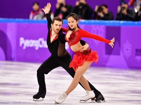 AFP_ZE0BY.jpg South Korea's Yura Min and South Korea's Alexander Gamelin compete in the figure skating team event ice dance short dance during the Pyeongchang 2018 Winter Olympic Games at the Gangneung Ice Arena in Gangneung on February 11, 2018. / AFP PHOTO / Mladen ANTONOVMLADEN ANTONOV/AFP/Getty Images
