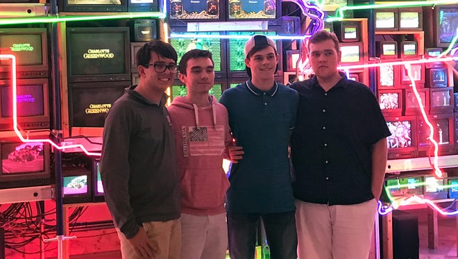 "Henderson County High School quick recall team members Zachary Beickman, Harrison Jenkins, Alex Chandler and DJ Banks pose in front of the art installation ""The Electronic Superhighway"" at the Smithsonian American Art Museum in Washington, D.C."