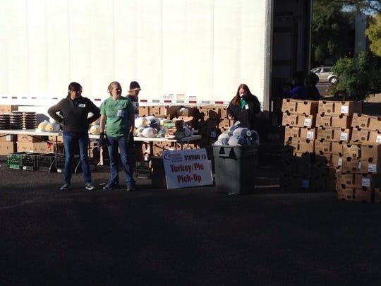 Volunteers distribute turkeys last year at Matthew's