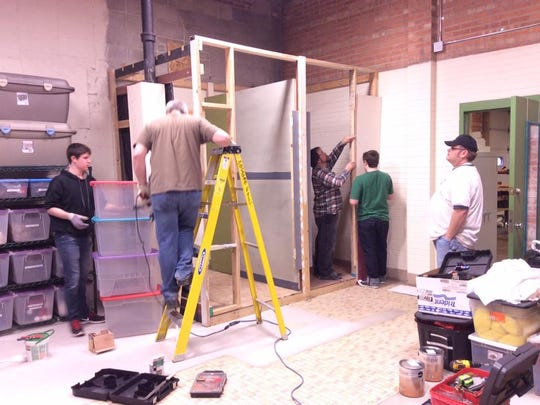 Boy Scout Parker Hambrick's team of volunteers assist in the building of changing rooms at Fond du Lac Community Theatre's property, which was the focus of his Eagle Scout project.