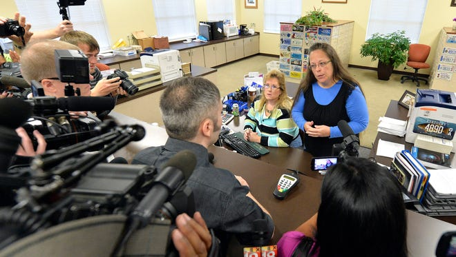 Rowan County Clerk Kim Davis, right, talks with David Moore following her office's refusal to issue marriage licenses at the Rowan County Courthouse in Morehead, Ky., Tuesday, Sept. 1. Although her appeal to the U.S. Supreme Court was denied, Davis still refuses to issue marriage licenses.