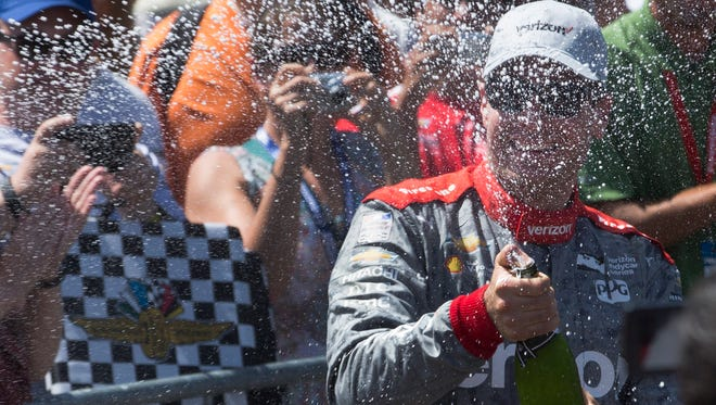 Will Power sprays Champagne on fans after his victory at the 2016 Verizon IndyCar Series Kohler Grand Prix  at Road America.