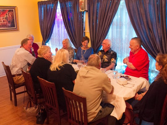 A group eats at Blue Windows Bistro earlier this month.