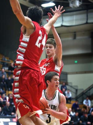 Grant Gelon, rear, in red, committed to IU on Wednesday.