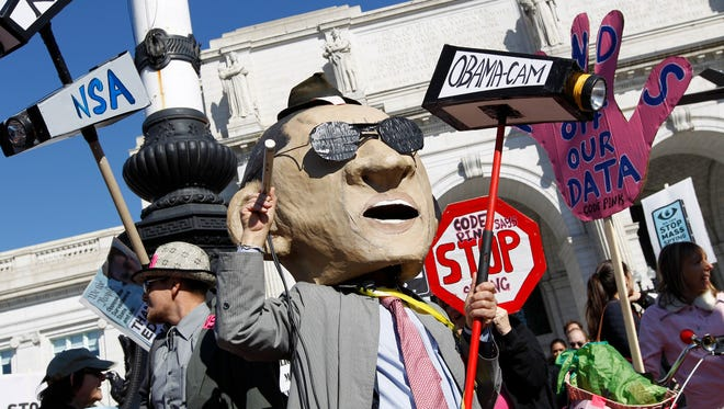 Demonstrators rally Saturday in Washington, D.C., for an end to NSA surveillance.