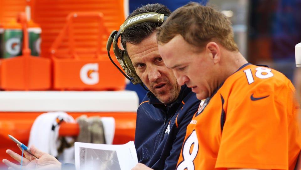 Broncos offensive coordinator Rick Dennison, left,
