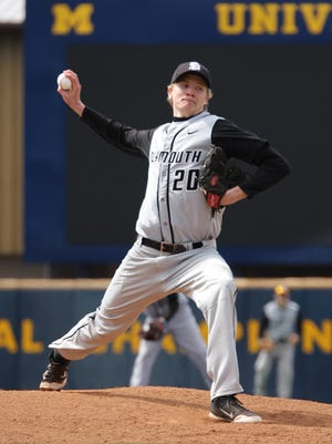 Plymouth senior Patrick Downing pitches during an early season game at the University of Michigan.