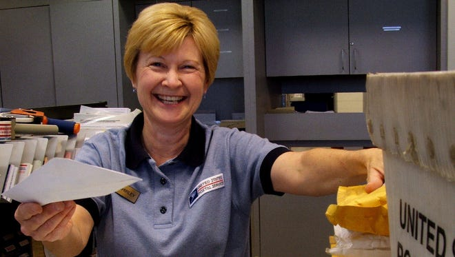 Perpetually cheerful Shirley Goss and this smile are well-known sights to patrons of North Liberty Post Office -- for more than two decades now.
