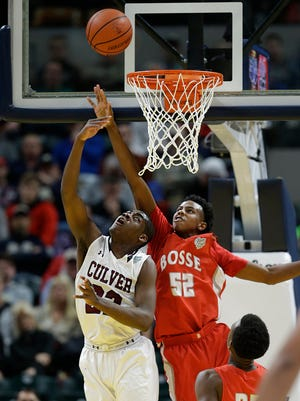 Bosse's Kiyron Powell (52) defends a shot against Culver in the Class 3A state championship in March. The junior forward received a scholarship offer from Xavier.