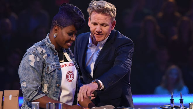 'Empire' star Ta'Rhonda Jones, left, gets pointers from Gordon Ramsay on 'MasterChef Celebrity Showdown.'