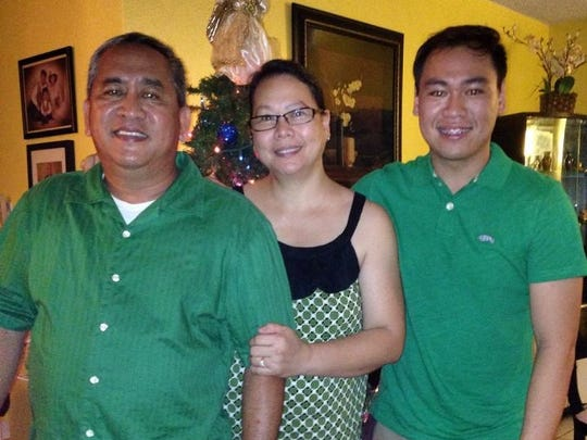 The Taladoc family wears matching colors together.