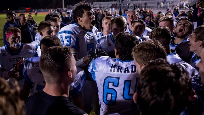 Richmond players celebrate beating Algonac to win the BWAC title Friday, Oct. 14, 2016 at Algonac High School.