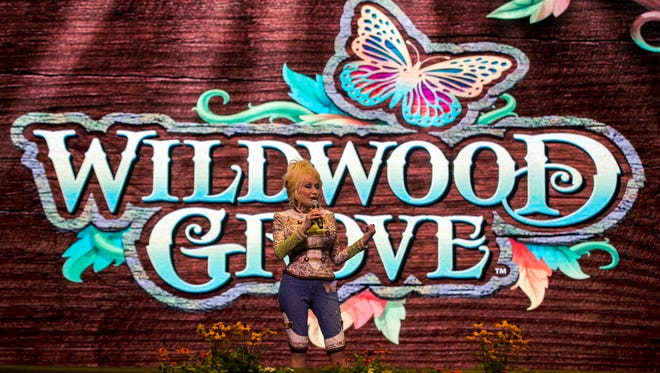 Dolly Parton speaks during an event announcing Dollywood's newest expansion named Wildwood Grove on Friday, August 3, 2018.
