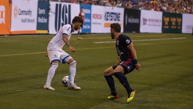Two players play during an Indy Eleven game.