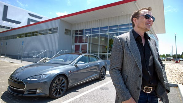 Tesla Model S electric luxury car and Tesla founder and CEO Elon Musk at the company's facotry in California.