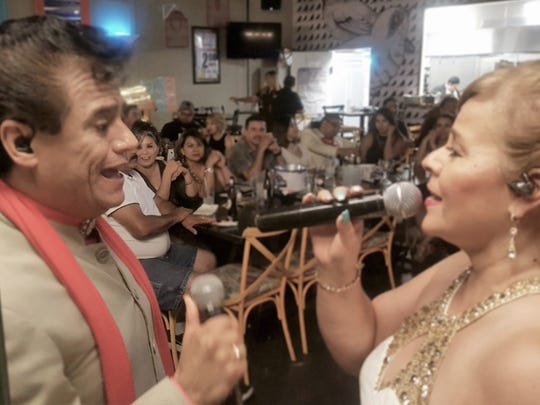 """Hugo Cortés, known as """"La J.G. de Juárez,"""" and his wife, Lily, have a long and well-known act interpreting Juan Gabriel songs."""