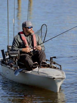 Brandon Barton fishes from his kayak in Big Lagoon on Sunday, Nov. 26, 2017.