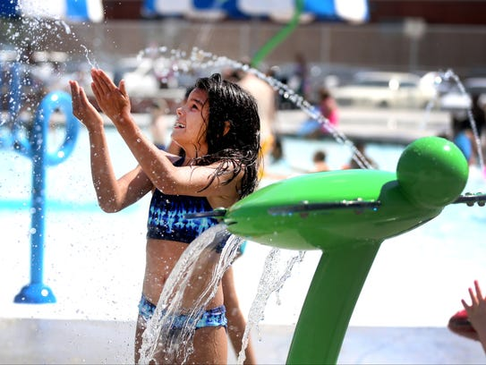 Hope Hane plays at Splash Town at the Smyrna Outdoor Adventure Center pool last summer.