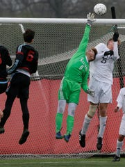 Marquette goalkeeper Carter Abbott makes a save in a game last season.