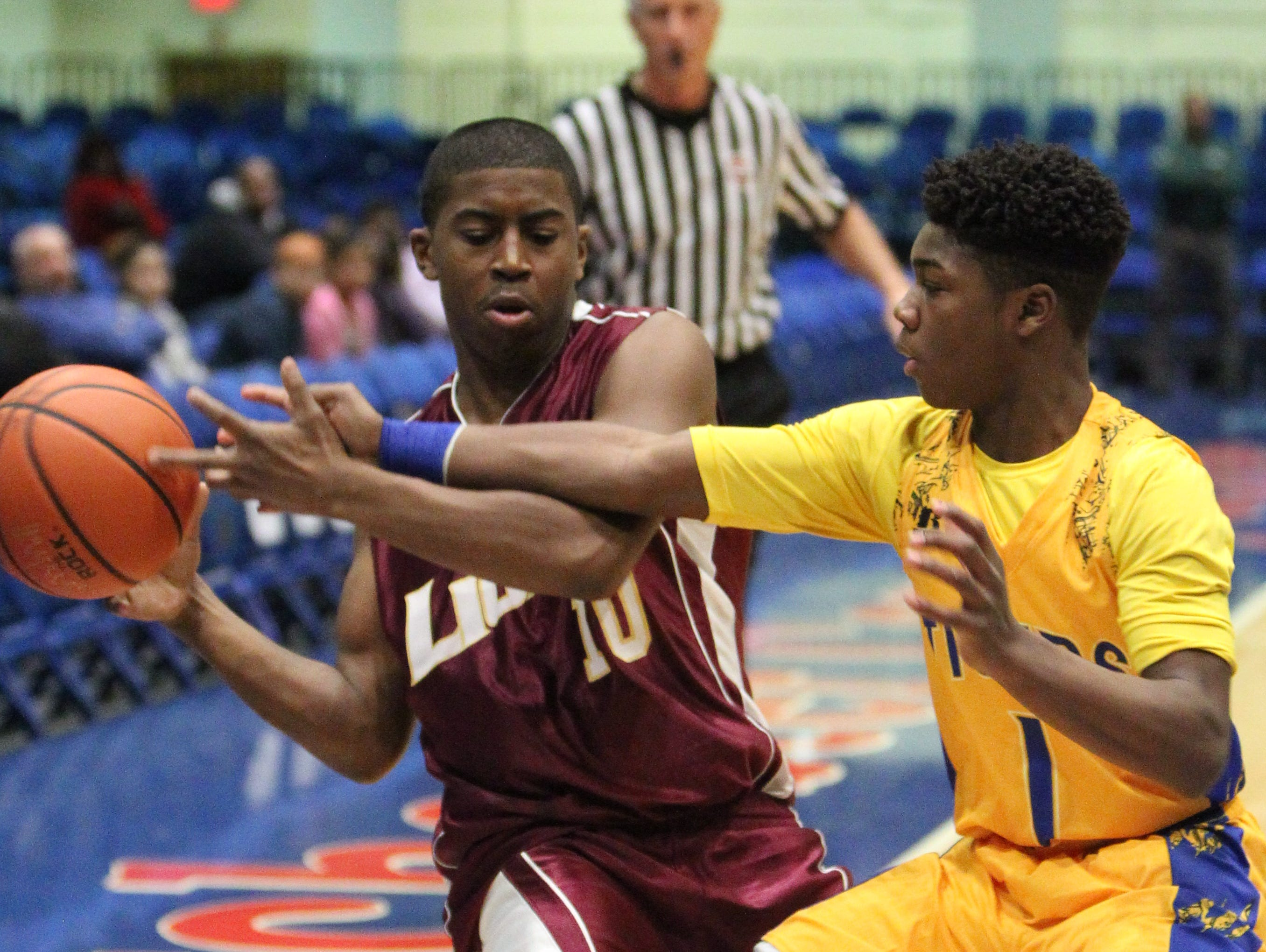 Biondi's Tyrese Ricks is pressured by Martin Luther King's Romello Faison during their Section 1 Class D semifinal at the Westchester County Center Feb. 19, 2016.