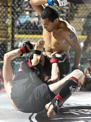 Farmersville's Manuel Ruiz defeated Santa Barbara's Beau Brooks via a second-round rear naked choke during Friday's 559 Fights 48 at Recreation Park in Visalia.