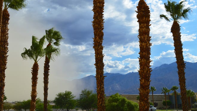 """The edge of a dust storm, or """"haboob,"""" sweeps across the Palm Springs International Airport on Thursday, Aug. 21, 2014."""