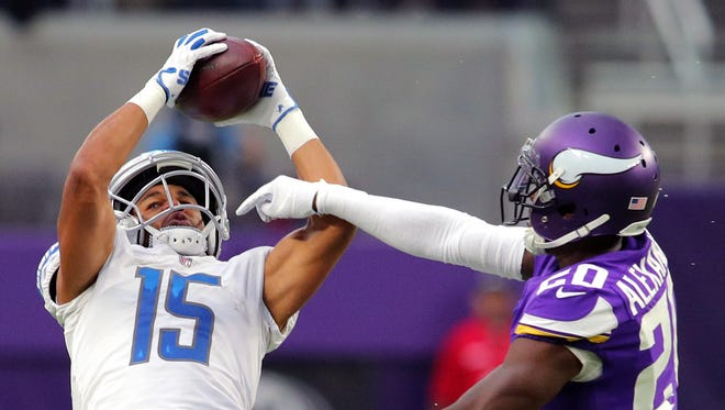 Golden Tate catches a pass over the Vikings' Mackensie Alexander in the second quarter Sunday, Oct. 1, 2017 at U.S. Bank Stadium in Minneapolis.