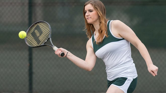 Shasta College freshman Ivory McCain connects on a shot. McCain swam in high school but had never played organized tennis before joining the Knights women's tennis team.