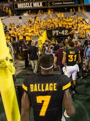 ASU's Kalen Ballage (7) leaves the field after scoring