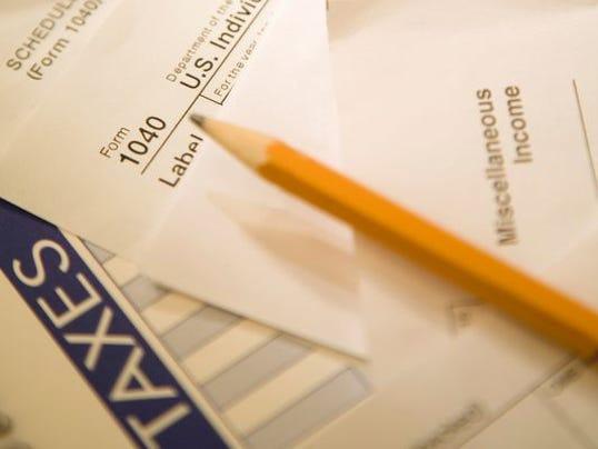_media_LA Group_LafayetteLA_2014_06_23_1403539999000-taxes (2).jpg