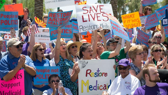 Medicaid- expansion supporters at a 2013 rally.