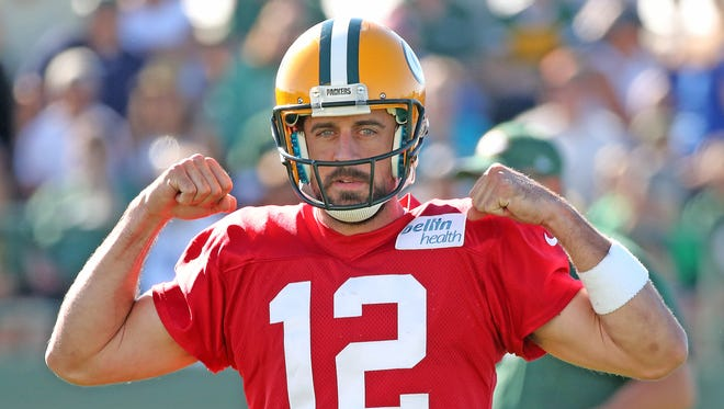 Green Bay Packers quarterback Aaron Rodgers (12) flexes after making a tough throw during training camp practice Saturday, July 29, 2017, at Ray Nitschke Field.