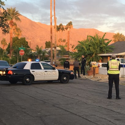 Multiple police cars gather at a Palm Springs home